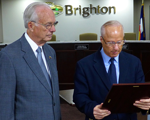 U.S. Representative Mike Coffman (right) presents Pastor Rex Bell with Congressional Citation, Brighton, May 1, 2018
