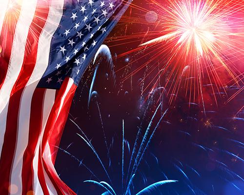 U.S. flag and fireworks closeup