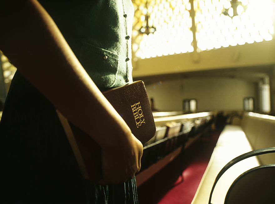 Holding Bible in Church