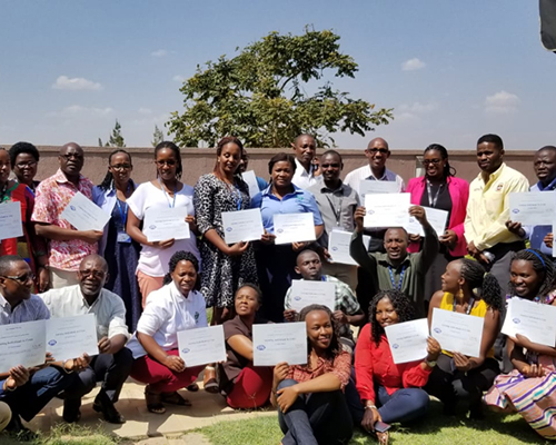 "Participants of the three-day training on ""Assisting Individuals in Crisis"" display their certificates of completion."