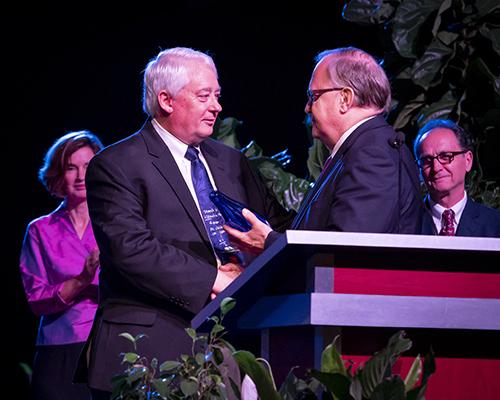 Larry Blackmer receives award from Dan Jackson