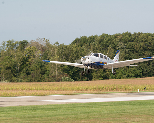 A plane lands at the university's Andrews Airpark.