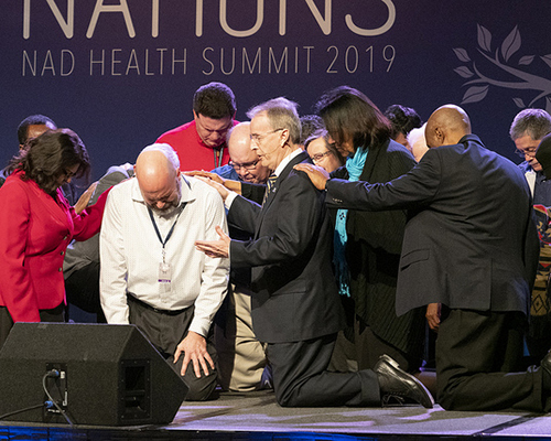 Derek Morris, president of Hope Channel International, overs special prayer.