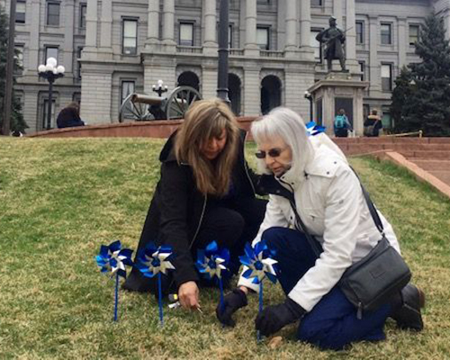 RMC employees with pinwheels