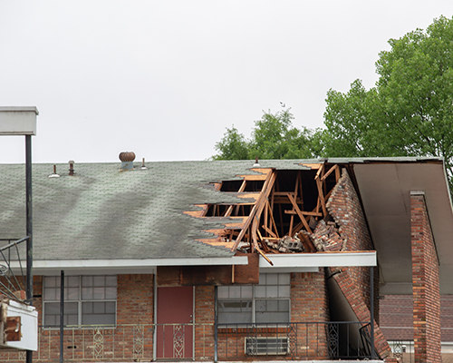 stock photo of tornado damage to apartment building