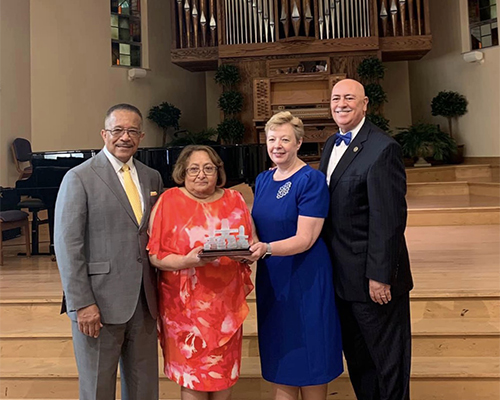 Buford Griffith, Carmen Griffith, Pamela Consuegra, and Claudio Consuegra, pose during an award presentation of the NAD Family Ministries' annual Family Research and Practice Conference.