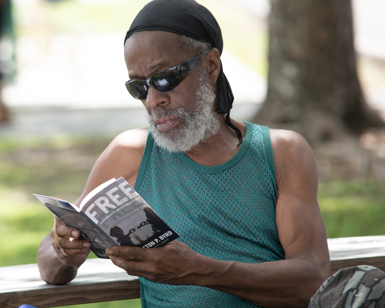 Community member in Miami-area reads a copy of FREE