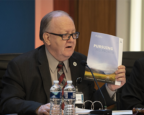 Daniel R. Jackson, holds up the program for the 2019 Year-End Meeting of the North American Division.