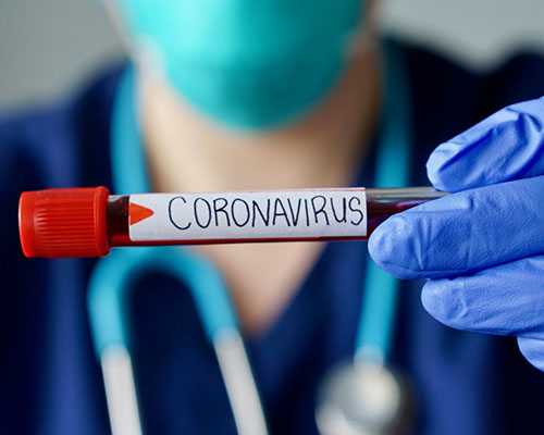 nurse with coronavirus vial