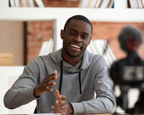 stock photo of african american man lecturing on camera