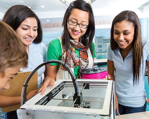 stock photo of students and teacher around 3D printer