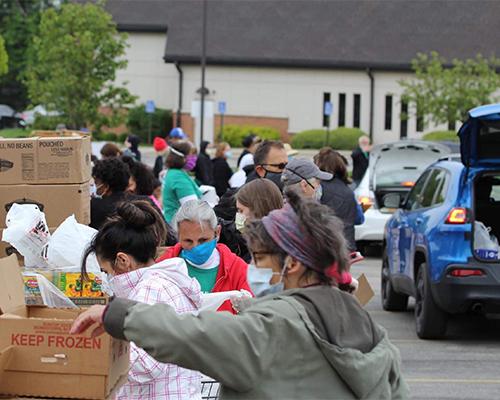 Renewed Hope volunteers sort food for distribution.