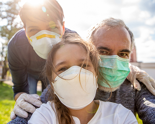 stock photo of family wearing masks