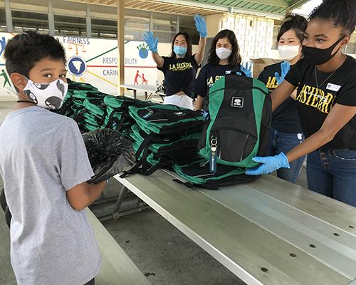 La Sierra University backpack giveaway with partner ADRA