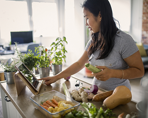woman cooking healthful meal stock photo