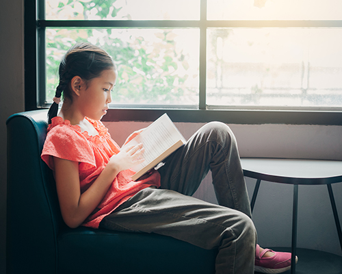 stock photo of girl reading by window