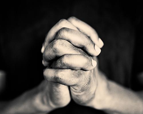 stock photo of praying hands