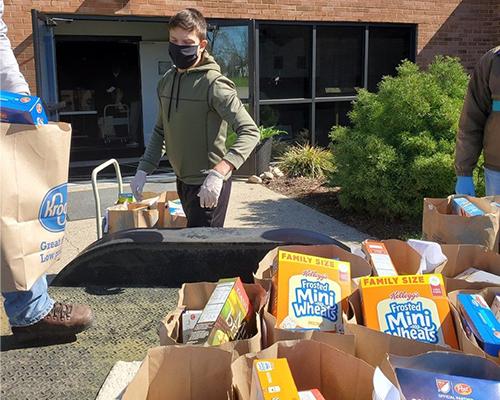 Volunteer organizes food at the Jackson Community Services Center in Jackson, Michigan.