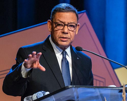 Juan R. Prestol-Puesán speaking at a podium