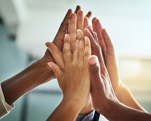 istock photo of hands in high five