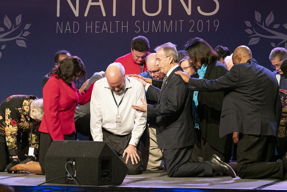 Derek Morris, featured speaker of the NAD Health Summit and president of Hope Channel International, offers special prayer. Photo: Dan Weber