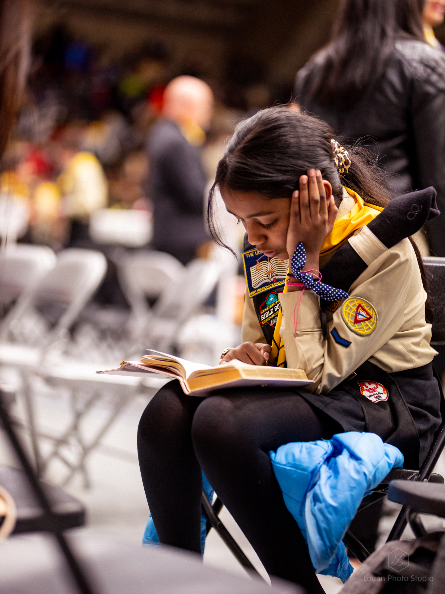 A pathfinder takes a moment to read the Bible.