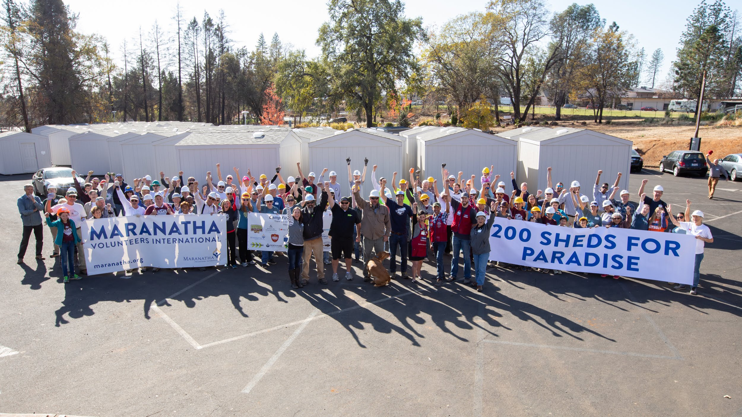 Volunteer builders celebrate the completion of more than 200 storage sheds for Paradise, California, residents who lost their homes in the 2018 Camp Fire. Photo by Tom Lloyd
