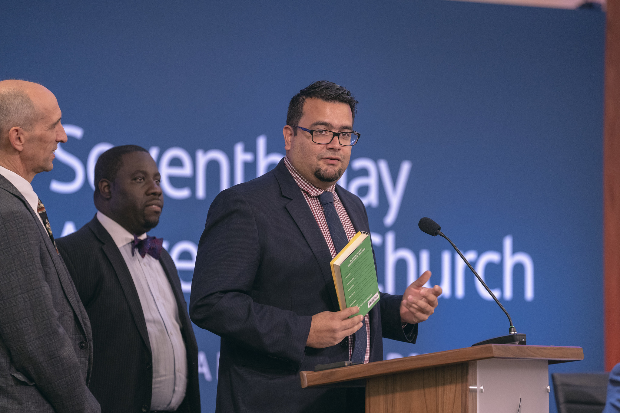 Armando Miranda, Youth and Young Adult Ministries associate director, highlights materials for young adults and ministry, including the Growing Young resource book. Photo by Dan Weber