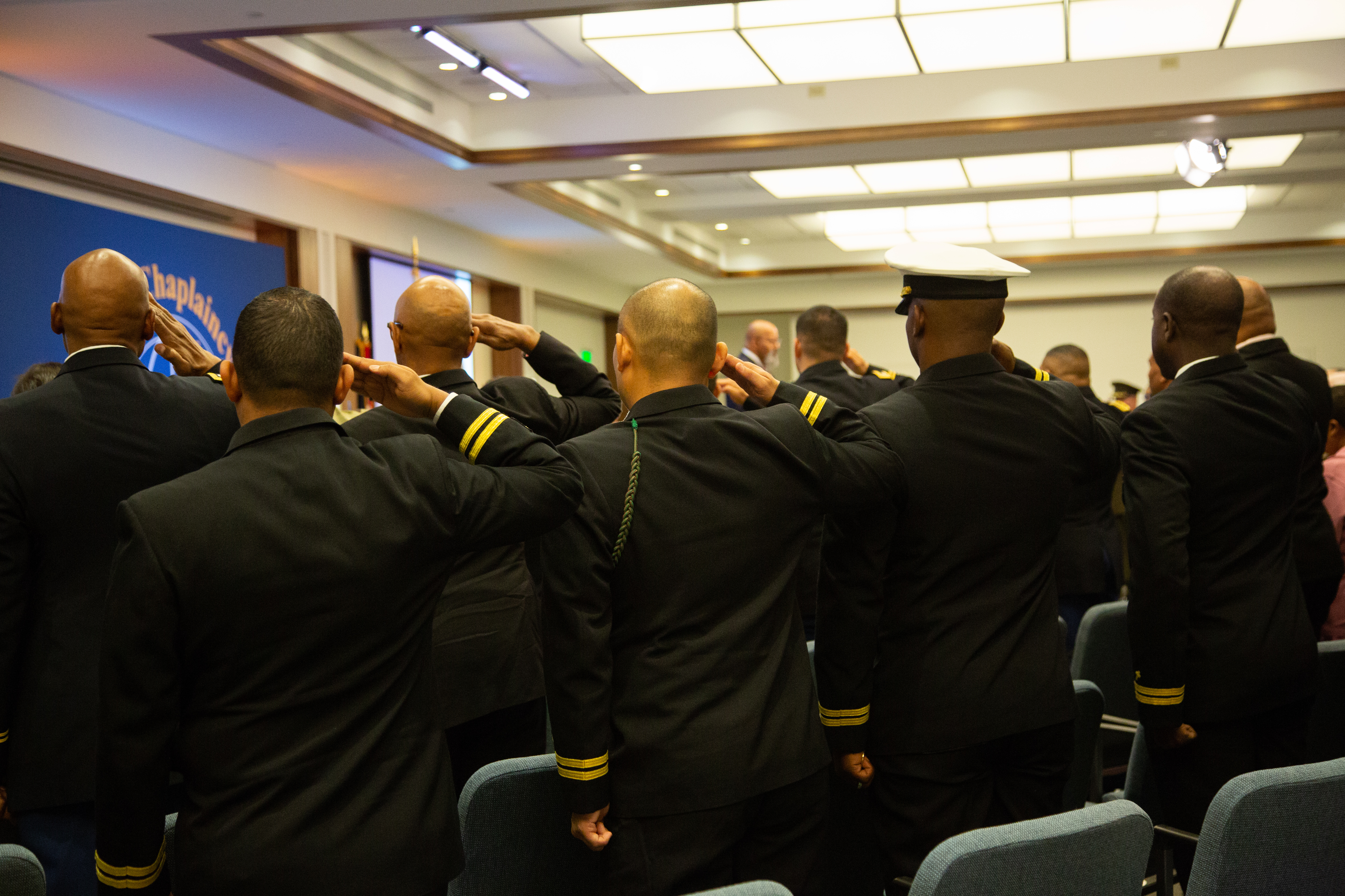 Servicemen salute in memory of Staff Sgt. Stacey Mastrapa who was killed in 2004 while serving in Iraq.