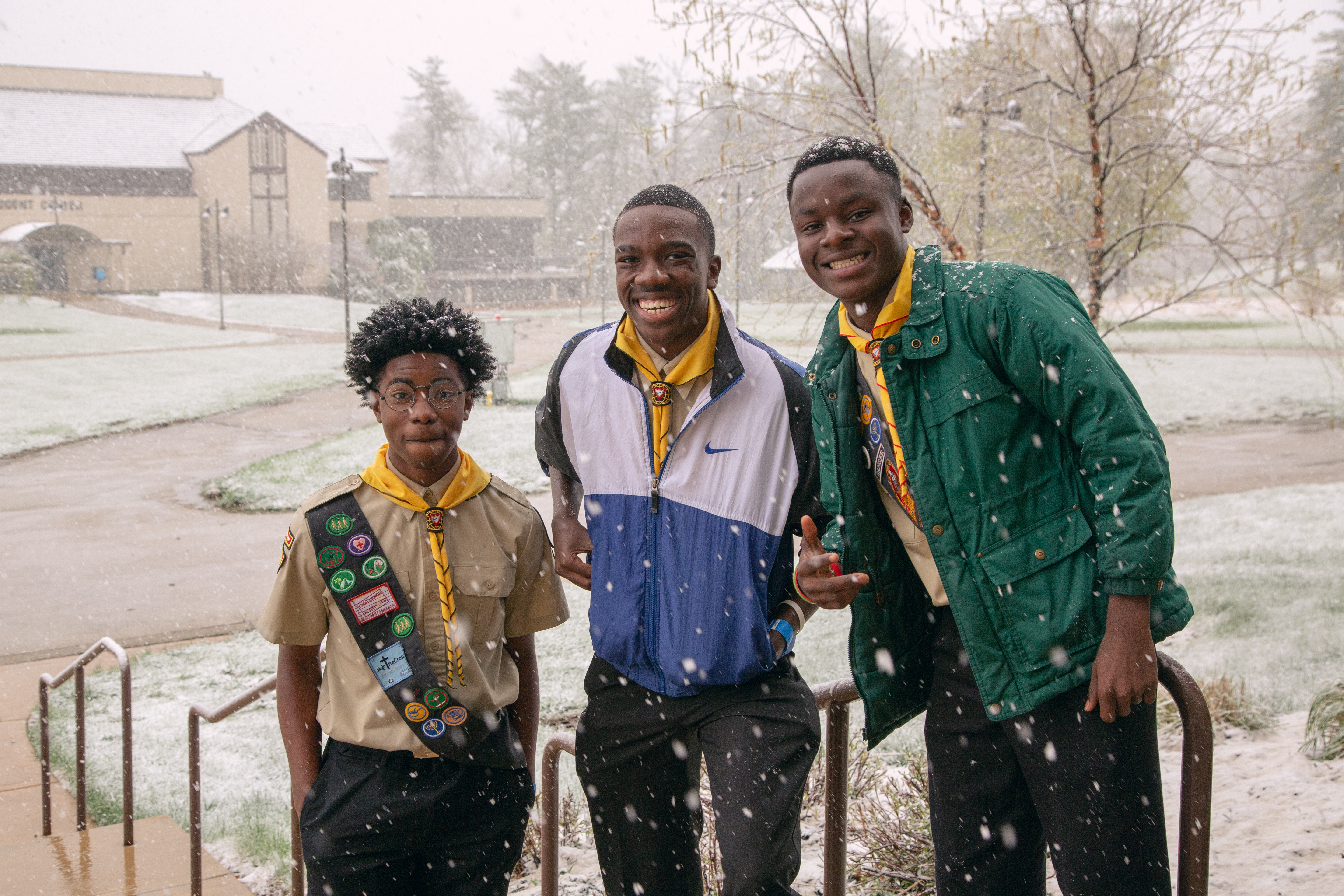 Group of friends pose in the snow outside the auditorium, a welcomed sight for Pathfinders from parts of the country that rarely experience snow.