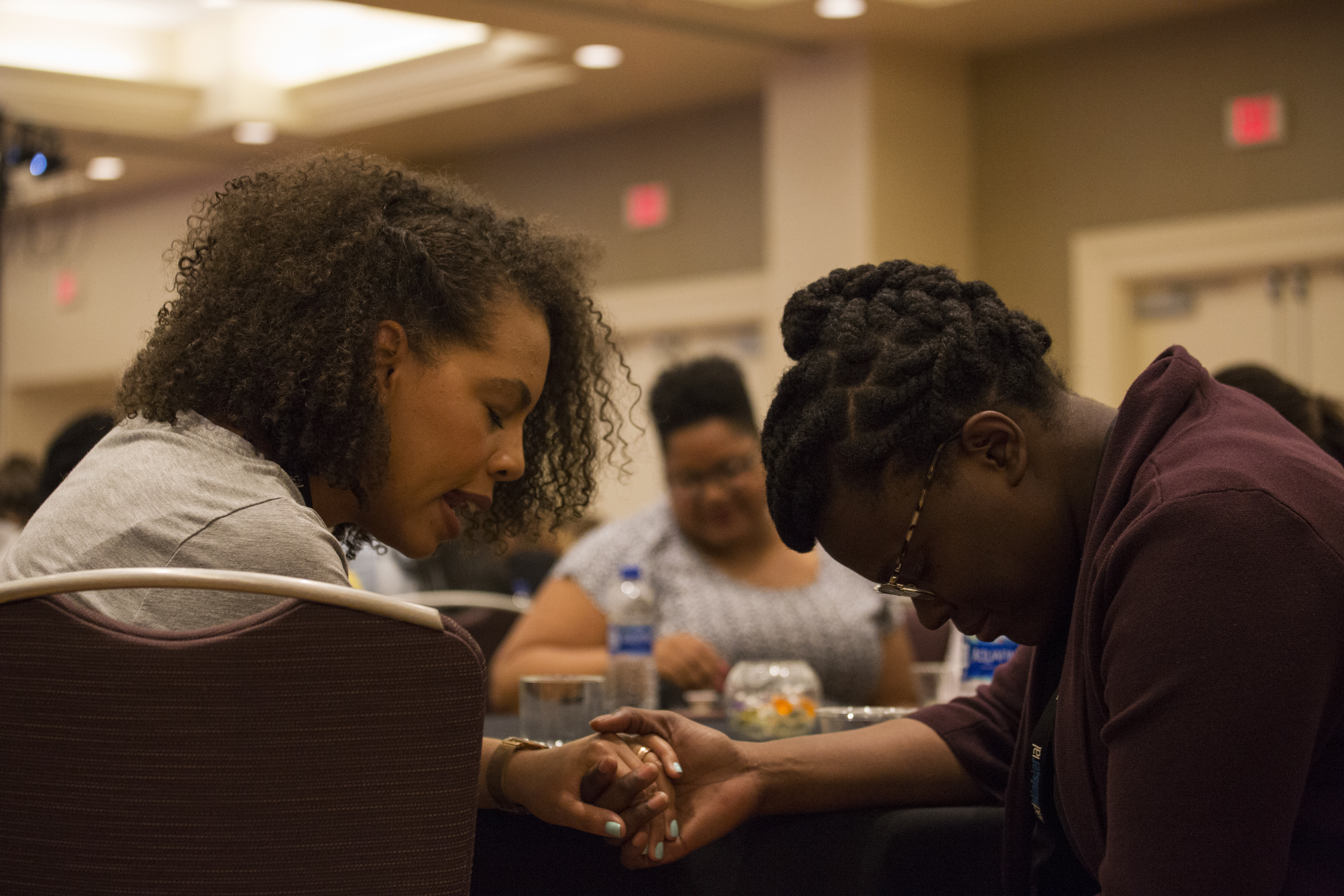 Two women clergy pray for each other during a general session of the 2018 NAD Women Clergy Retreat in Indian Hills, California.