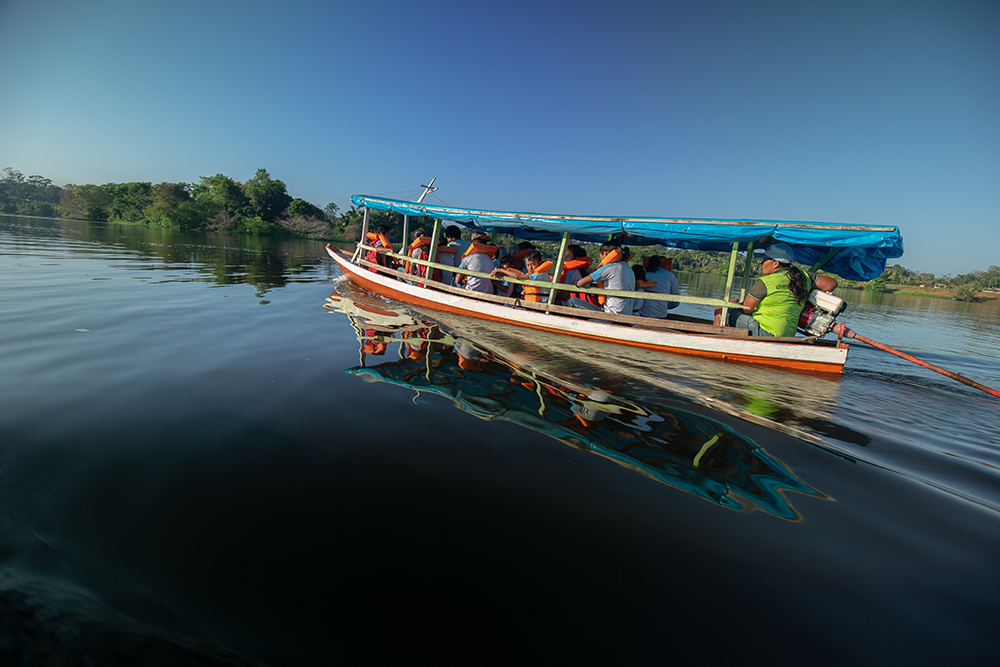 ETAM students traveling by boat to school
