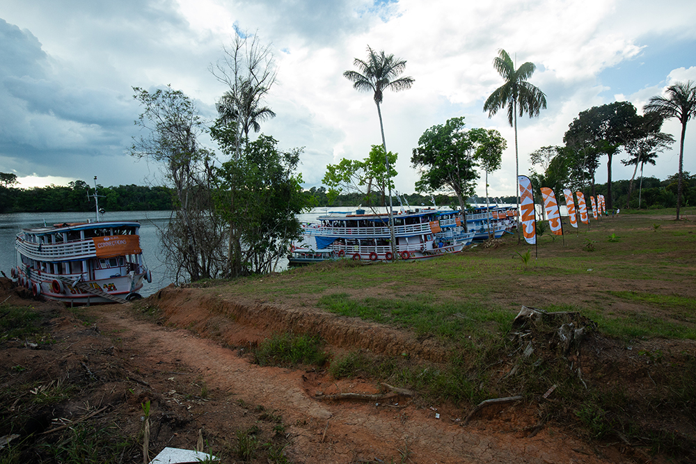 Amazon River boats, which served as living accommodations for the students and volunteers, sit on the shore line in front of the school
