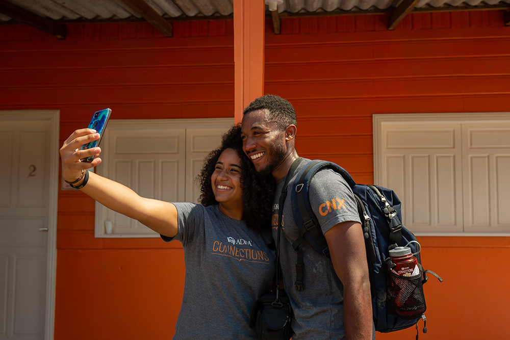 Caleb Akins (R)  who studies Spanish and broadcast journalism at Oakwood University shares a selfie with Raiane Porto (L) who studies music at the Adventist University of Sao Paulo in Brazil (UNASP).