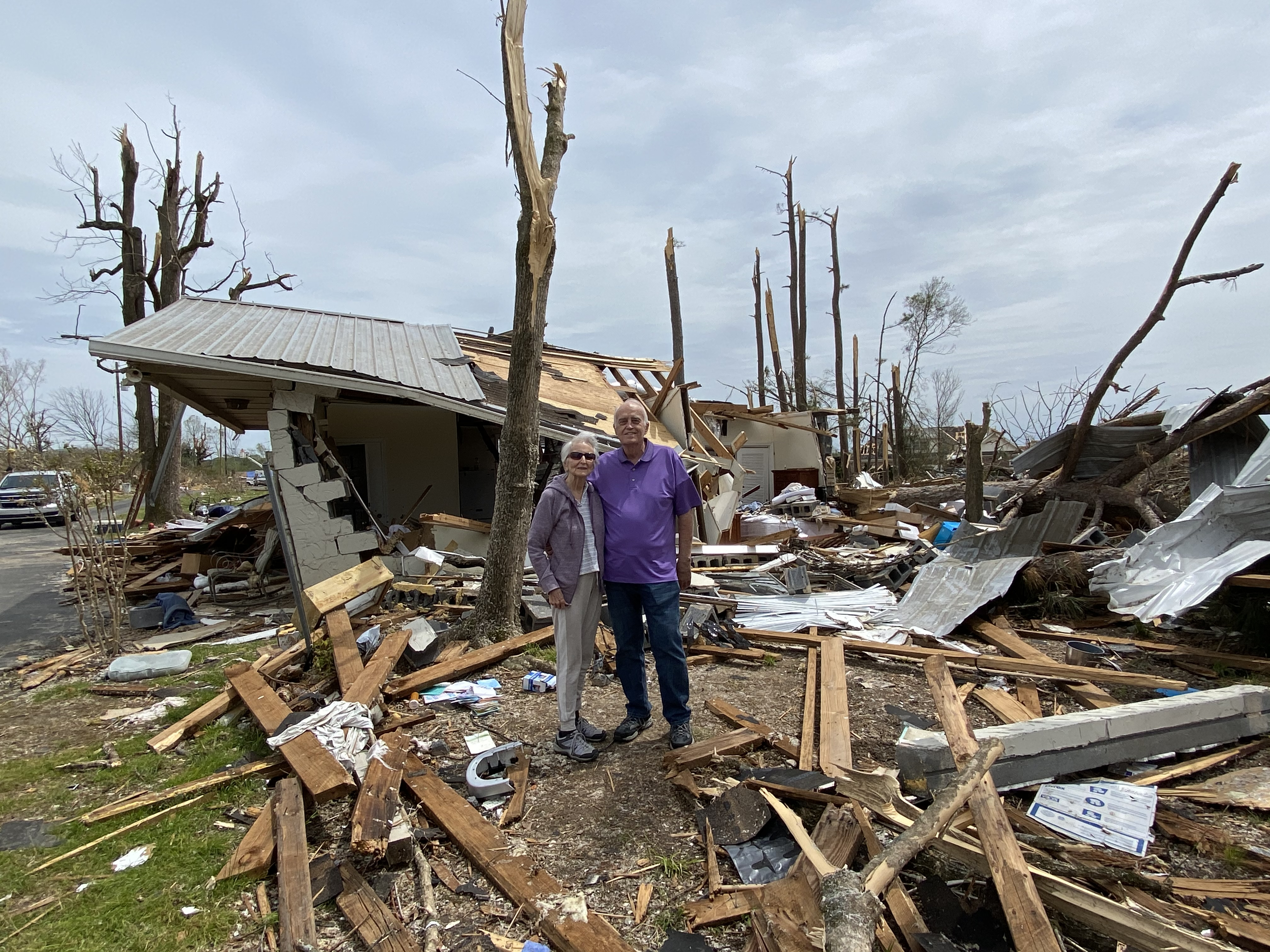 After a tornado ripped through their community, Bob and Lou Sauder stand in the rubble that was their house.