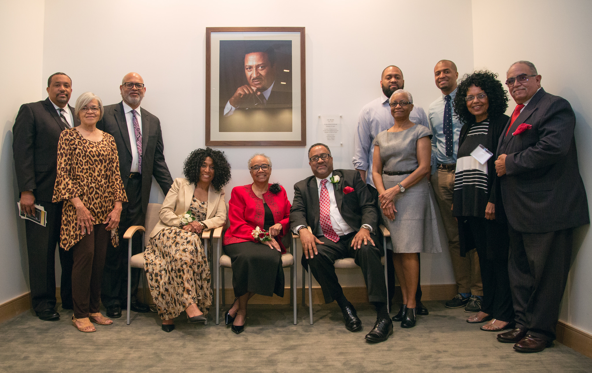 Members of the Brooks family pose under portrait of C.D. Brooks in the division headquarter's prayer chapel.