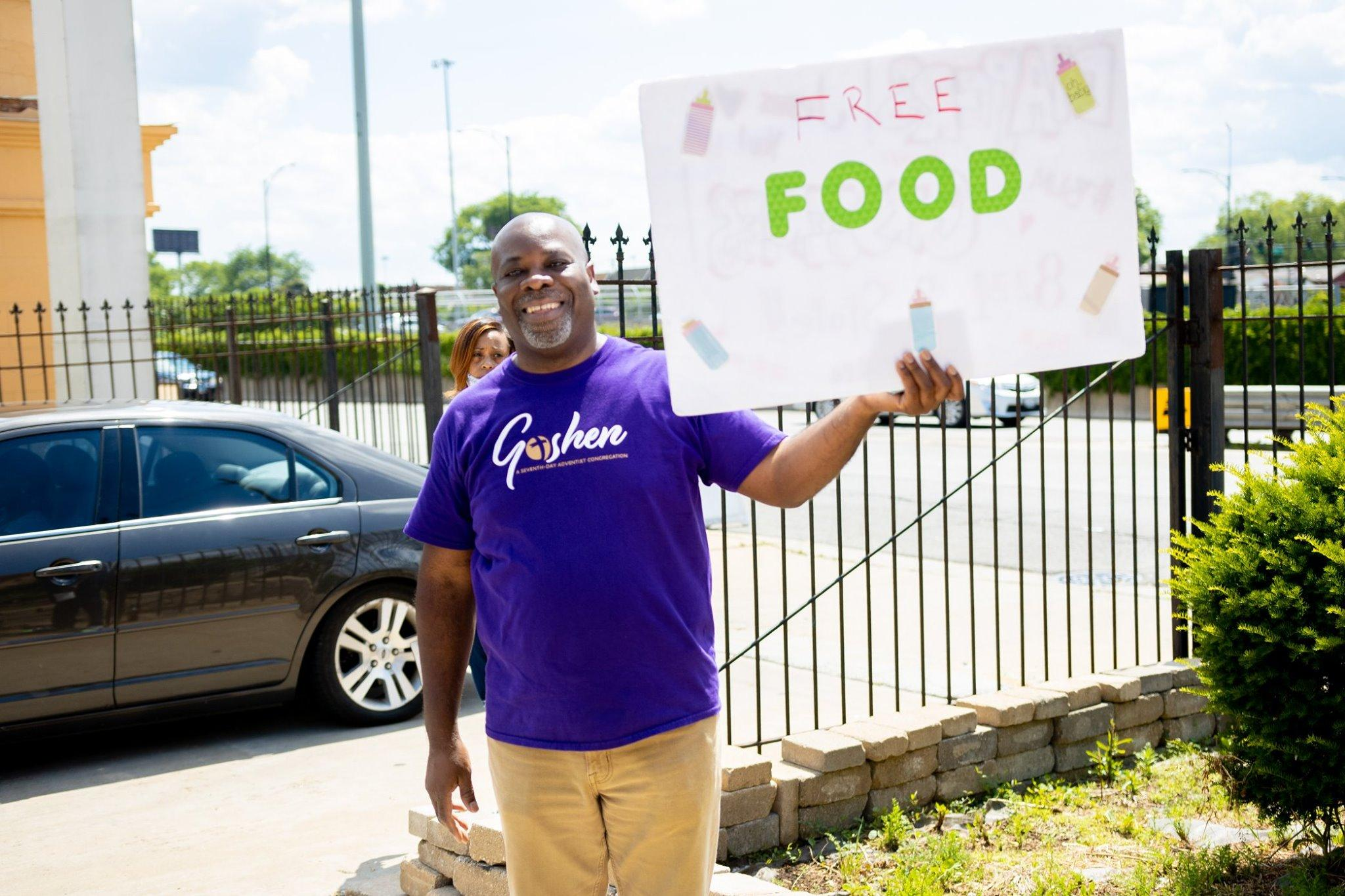 Chicago Goshen church pastor Gordon Graser promotes the food giveaway June 2020 5305.jpg