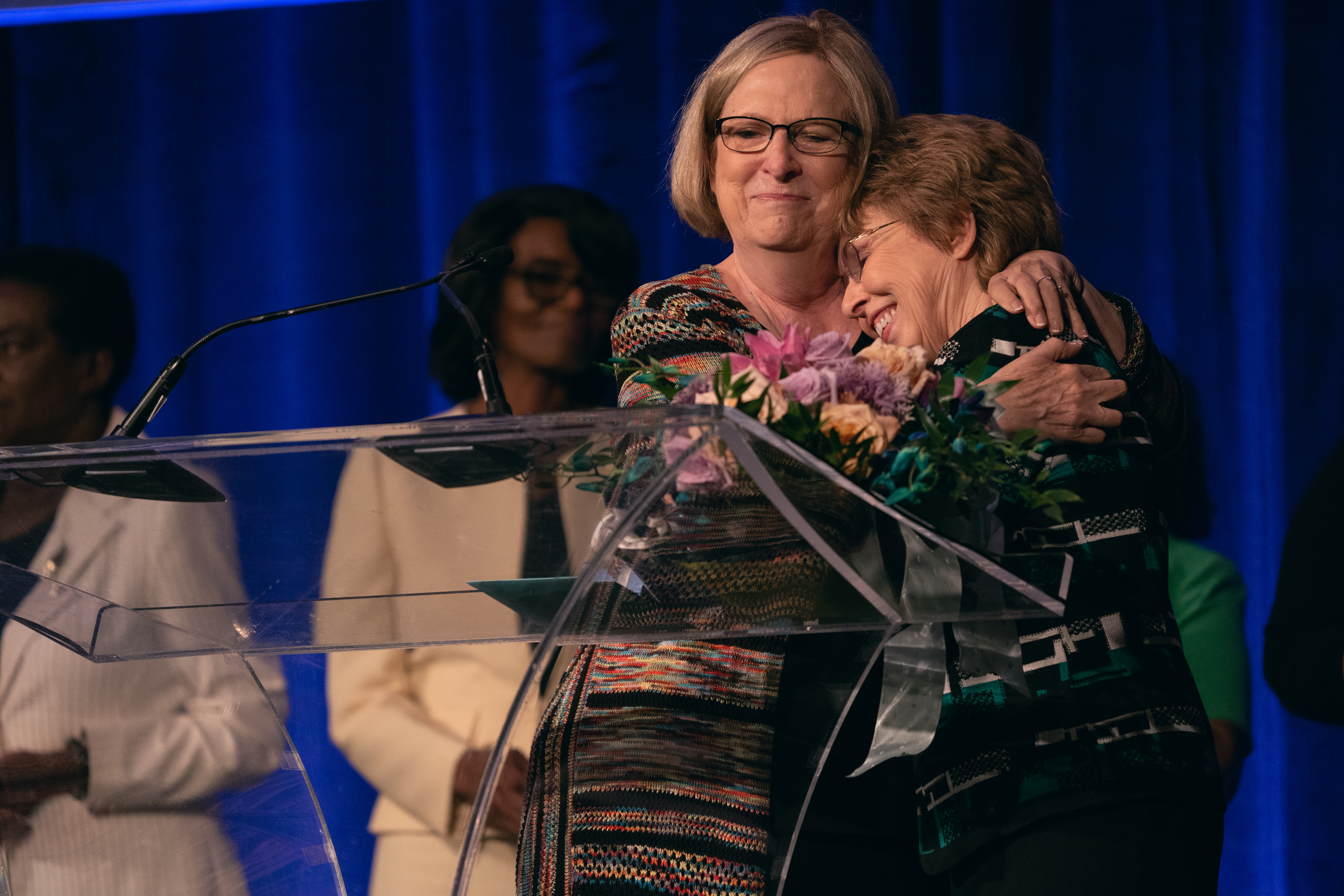 Nancy Buxton, director of Women's Ministries for the Mid-America Union, embraces Carla Baker, director of Women's Ministries for the North American Division, during the surprise farewell ceremony. Baker has served NAD for 14 years.