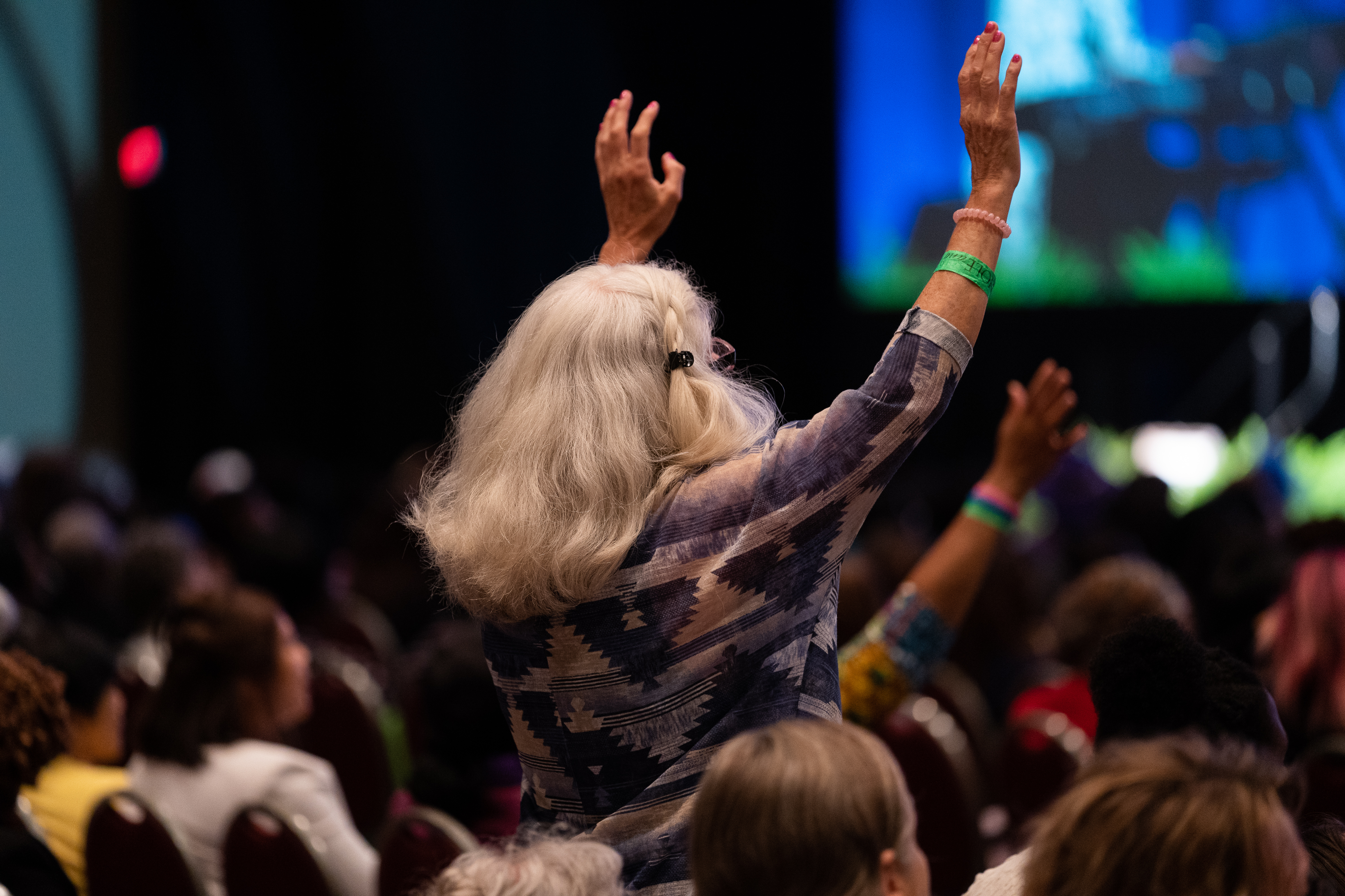 Convention attendee responds to praise and worship songs.