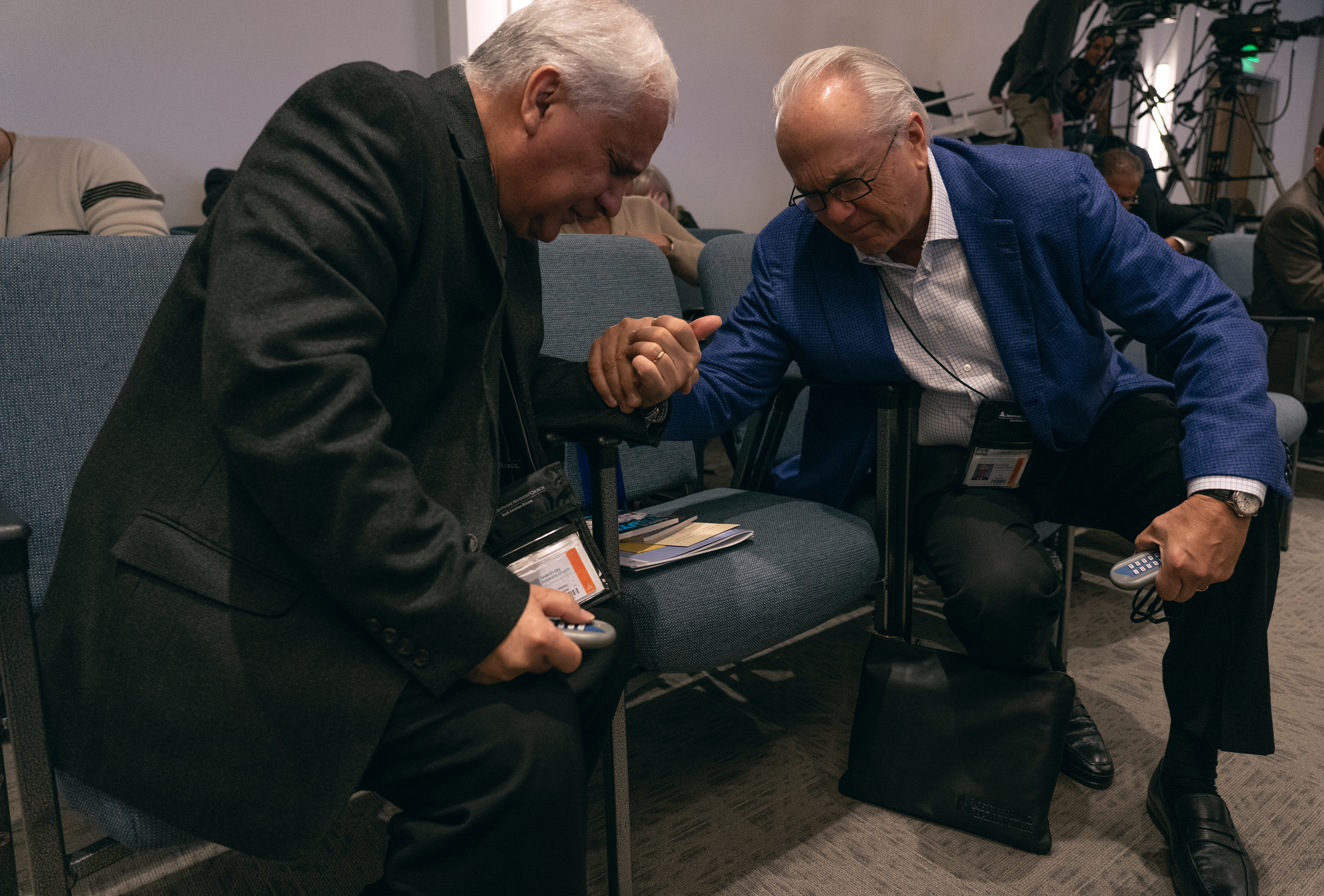 Two delegates pray before members of the NAD executive committee prepare to dialogue over how the General Conference responded to the body's requests for action regarding the voted document from the 2018 Annual Council session dealing with non-compliant Church entities, and NAD's financial parity.