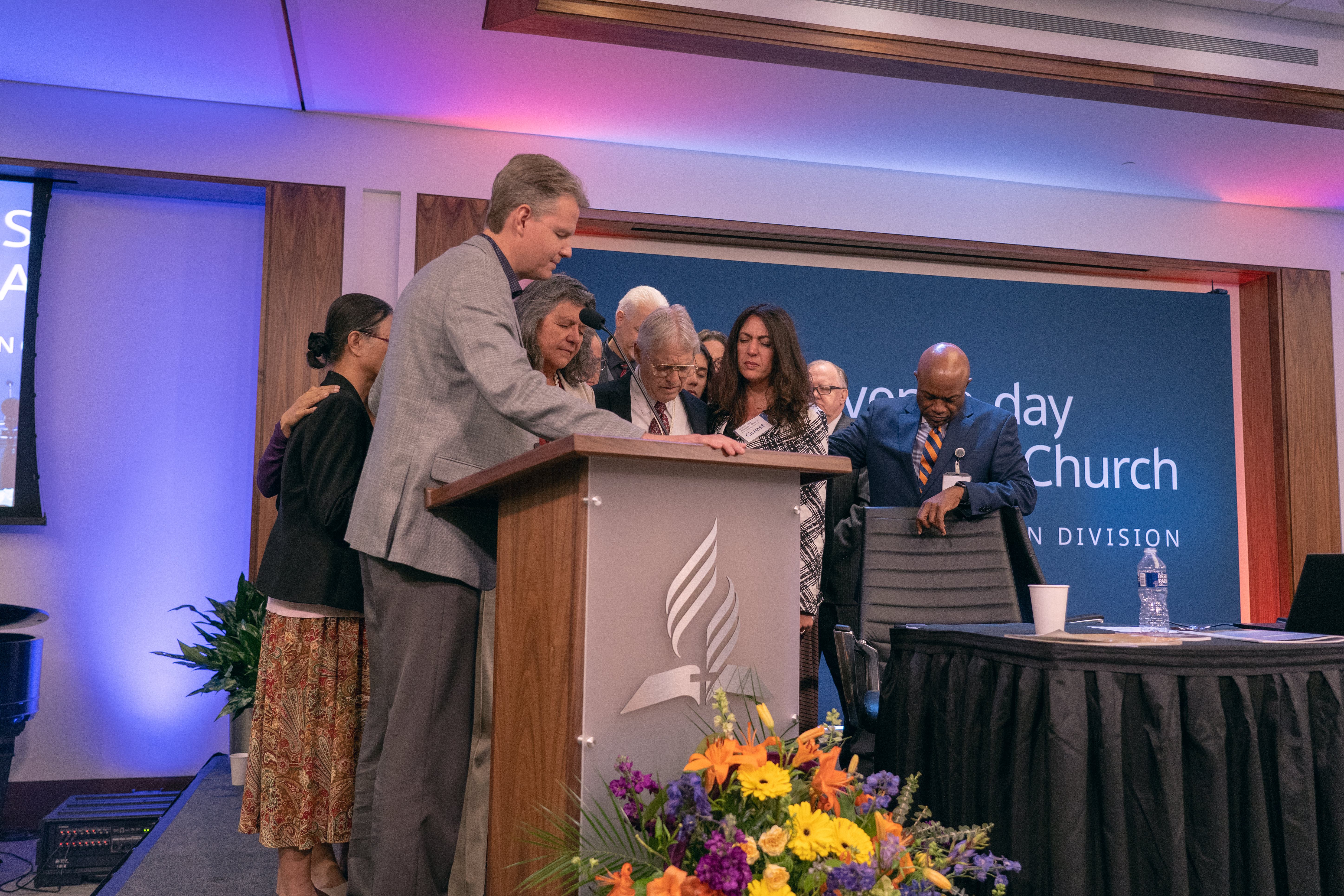 Ken Norton, president of the Guam-Micronesia Mission, prays over the parents, family, and friends of Kirsten Wolcott, the student missionary who was murdered while serving on the island of Yap 10 years ago.