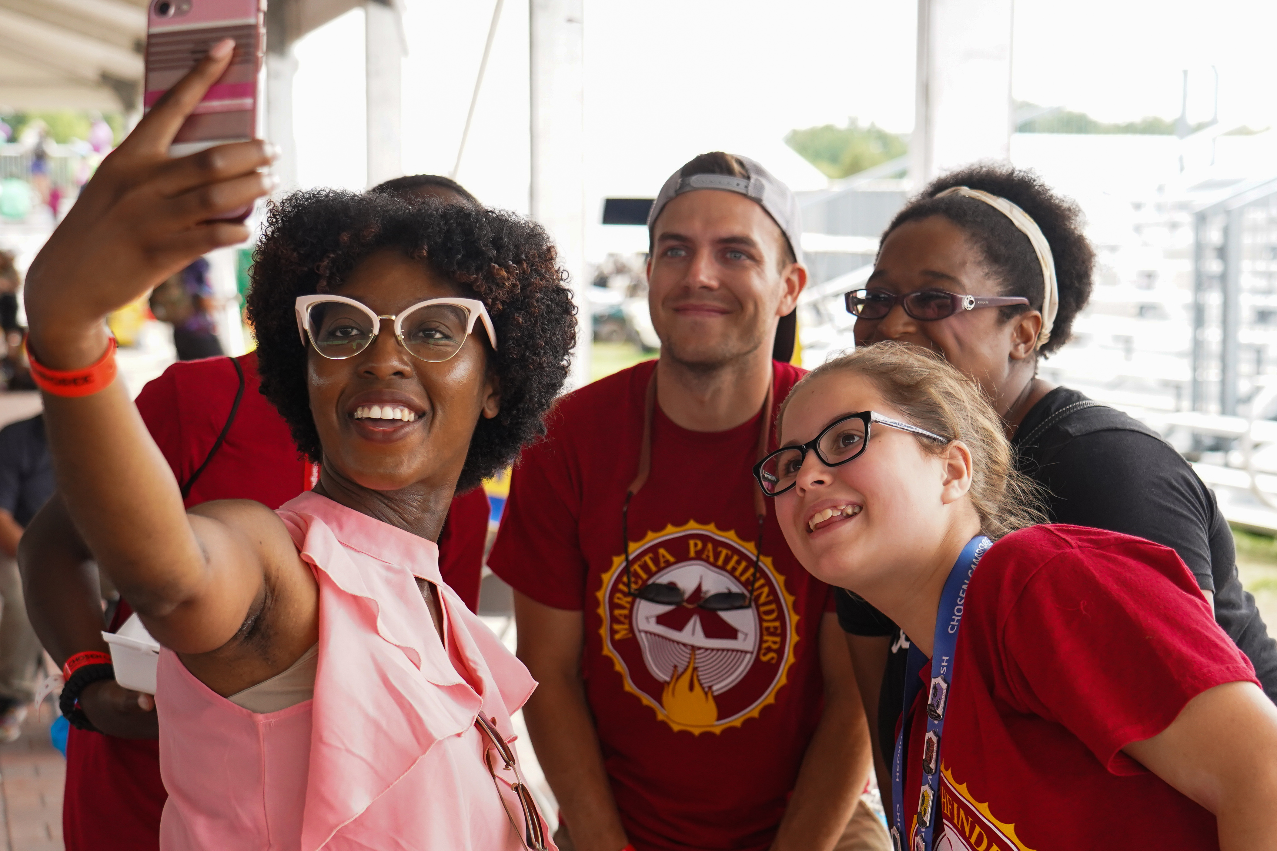 Darnisha Thomas, who pastors in the Minnesota Conference, takes a selfie with a group of Pathfinders for a selfie at the NextGen Ice Cream Social on August, 17.