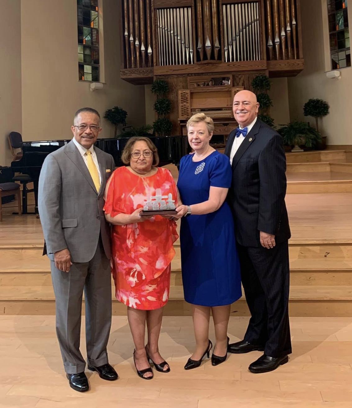 Buford Griffith, Carmen Griffith, Pamela Consuegra, and Claudio Consuegra, pose during an award presentation of the NAD Family Ministries' annual Family Research and Practice Conference