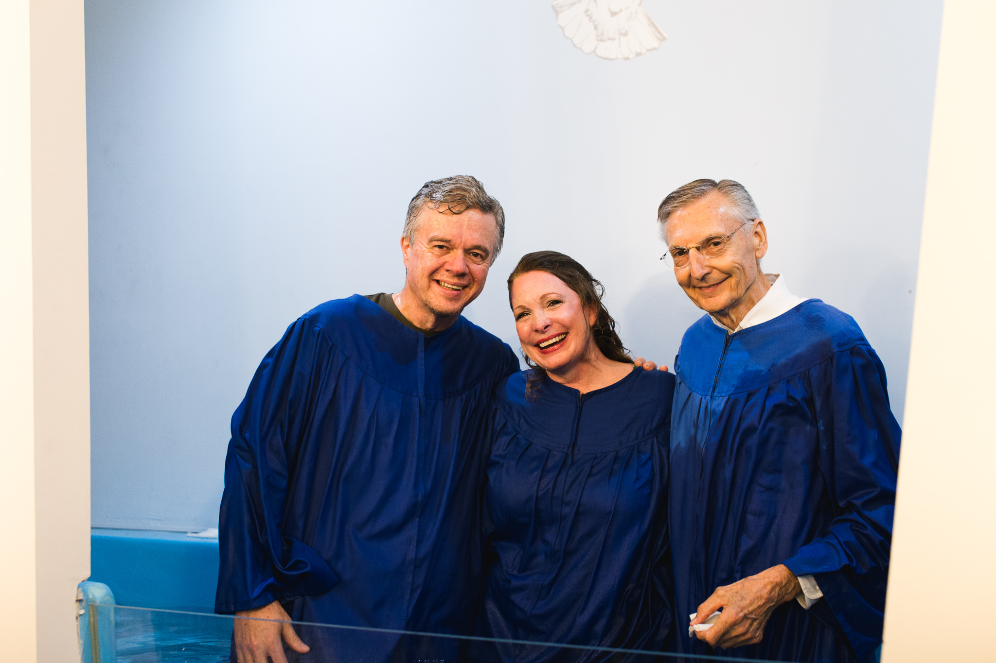 Hayes and Paige Parnell smile alongside Pastor Edward Skoretz after their baptism at Summerville Seventh-day Adventist Church in Summerville, Georgia.