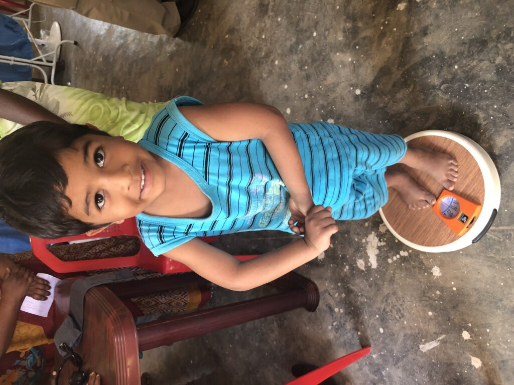 This boy is one of the villagers near one of the recently re-opened Adventist churches in east central India receive medical exams.