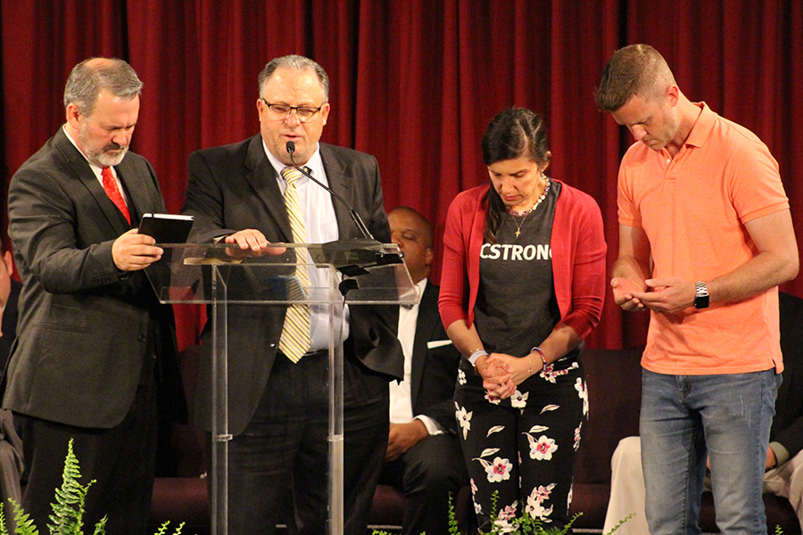 Robert Wagley offers prayer for Mayor Carrie Tergin and Jefferson City, Missouri, as fellas for Pastor Redman (right) and Jody Dickhaut as they serve their communities.