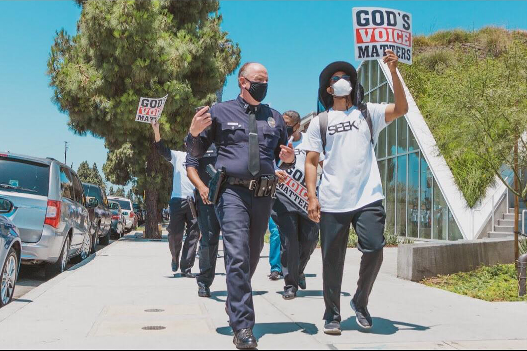 LAPD and Pastor Morris Barnes walk together during a June 3, 2020, march for justice and peace in Los Angeles.