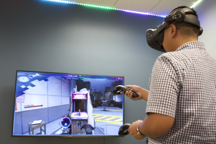 Student tries out a virtual reality video game in La Sierra University's new virtual reality and artificial intelligence lab.