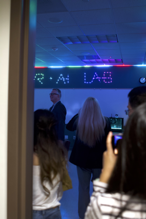 Visitors look around the new VR+AI Lab during a grand opening celebration