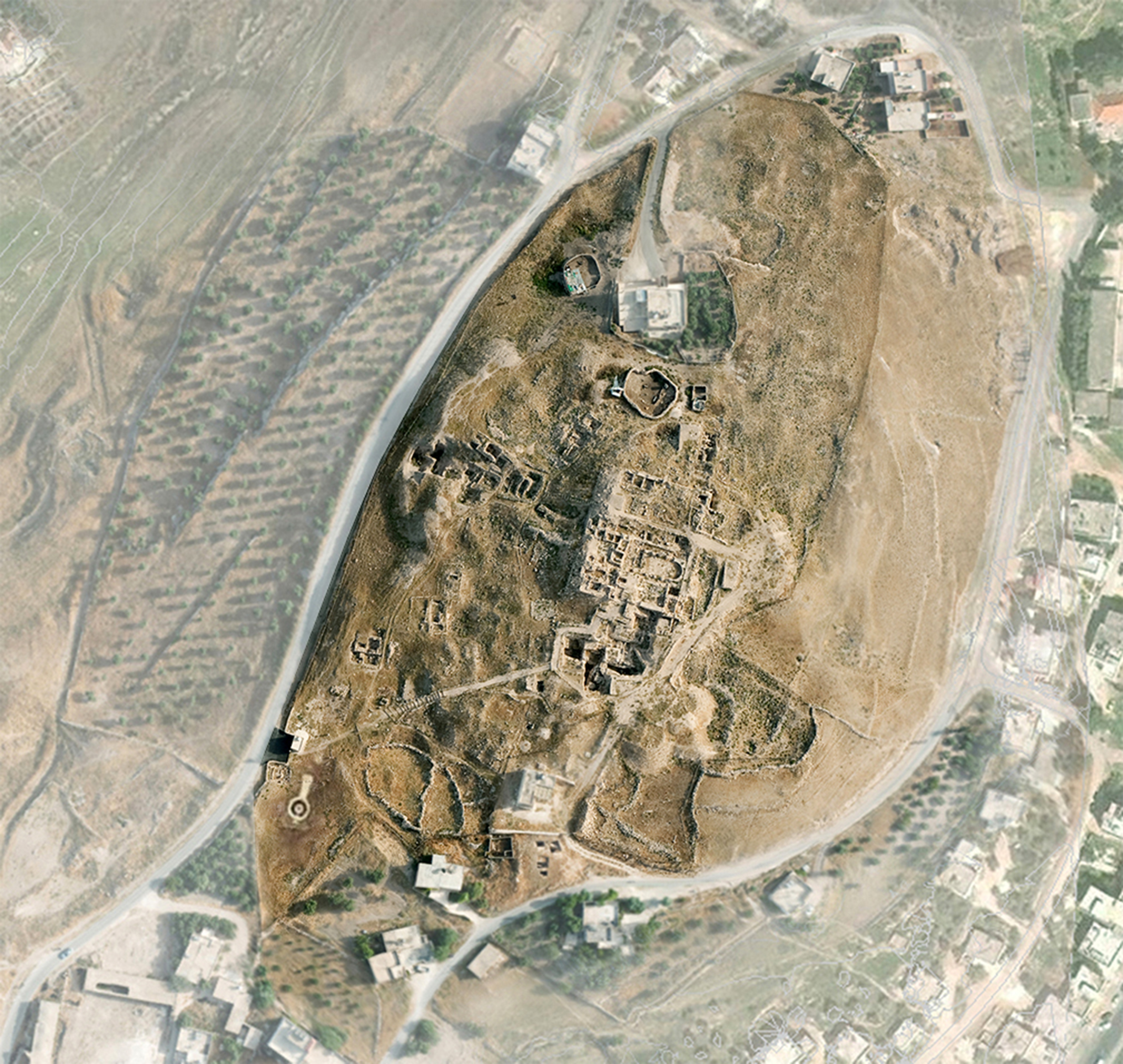 Aerial view of the excavation site Tall Hisban in Jordan co-founded in 1968 by archaeologist Dr. Larry Geraty in whose name an endowment has been established to protect and preserve the site. (Courtesy: Madaba Plains Project)